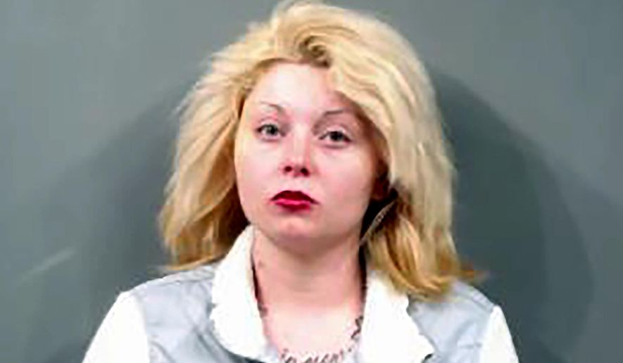 FILE -This Aug. 15, 2019, booking photo provided by the Sedgwick County, Kansas, Sheriff's Office shows Kimberly Compass, a mother who was arrested in the death of her 2-year-old son Zayden Jaynesahkluah, at a motel in Wichita on May 31, 2019. Kansas child welfare officials say they received repeated reports about the Wichita toddler before he died of an overdose of the addiction treatment medication methadone. The Kansas Department of Children and Families said Tuesday, Sept. 3 in response to a records request that that the initial reports in December 2018 and January 2019 were about neglect and lack of supervision of Zayden. (Sedgwick County Sheriff's Office via AP, File)