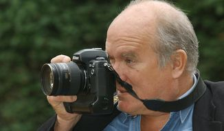 FILE - In this Jan. 18, 2008  file photo, star photographer Peter Lindbergh is taking a picture in Duesseldorf, Germany. The icon fashion photographer died at the age of 74. (Horst Ossinger/dpa via AP)