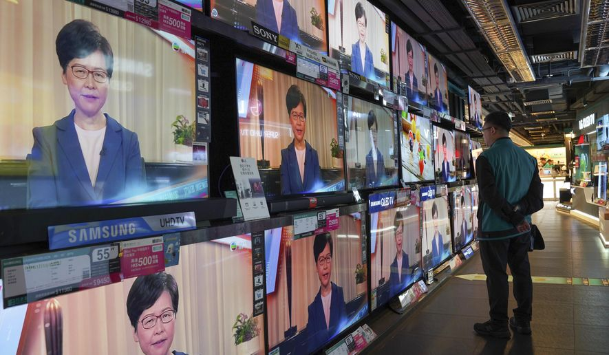 A man watches the television message that Hong Kong Chief Executive Carrie Lam makes an announcement on the extradition bill, at a home electronics retailer in Hong Kong, on Wednesday, Sept. 4, 2019. Chief Executive Lam has announced the government will formally withdraw an extradition bill that has sparked months of demonstrations in the city, bowing to one of the protesters' demands. The bill would have allowed Hong Kong residents to be sent to mainland China for trials. It sparked massive protests that have become increasingly violent and caused the airport to shut down earlier this month. (AP Photo/Vincent Yu)