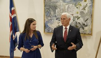 In this photo taken Wednesday, Sept.4, 2019, at Keflavik Airport, Iceland, U.S. Vice President Mike Pence meets with Iceland Prime Minister Katrin Jakobsdottir at the end of a seven hour visit to Iceland. Jakobsdottir had initially announced she would not be able to meet Pence due to a scheduling snafu but the two of them merged schedules days before Pence's arrival. (AP Photo/Egill Bjarnason)