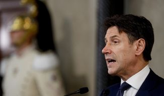 Italian Premier Giuseppe Conte meets the media at Rome's Quirinale Presidential Palace, Wednesday, Sept. 4, 2019. The Italian presidential palace says Premier Giuseppe Conte has formed a new government, a coalition of the populist 5-Star Movement and left-leaning Democrats that shuts out of power right-wing leader Matteo Salvini. (AP Photo/Gregorio Borgia)