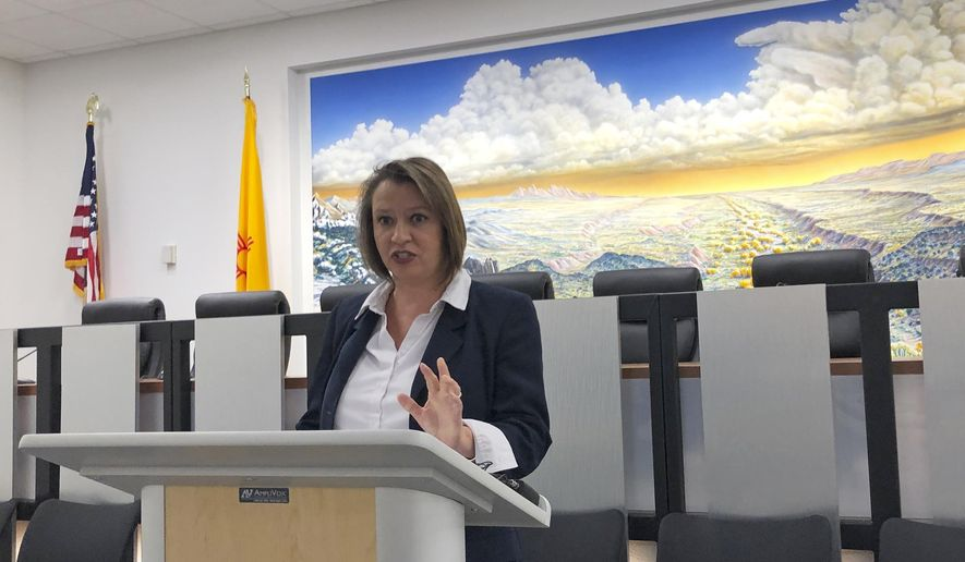 New Mexico State Land Commissioner Stephanie Garcia Richard announces on Wednesday, Sept. 4, 2019, in Santa Fe, N.M., the termination of public grazing leases to a holding company controlled by financier Jeffrey Epstein before his death last month. Garcia Richard says the leases were used to cast a veil of secrecy over Epstein's Zorro Ranch, and that access to state trust land has been blocked since Epstein's death. (AP Photo/Morgan Lee)