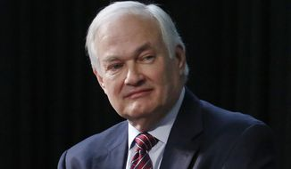 FILE - In this Jan. 24, 2015, file photo, NHL Players' Association Executive Director Donald Fehr listens during a press conference in Columbus, Ohio. The NHL Players' Association executive board and others meet Wednesday evening, Sept. 4, 2019, in Chicago, in advance of a Sept. 15 deadline to decide whether to terminate the current collective bargaining agreement. (AP Photo/Gene J. Puskar, File)