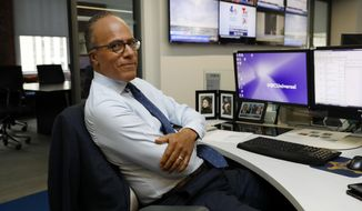 """This July 31, 2019 photo shows Lester Holt, anchor of """"NBC Nightly News,"""" and host of """"Dateline NBC"""" posing at his news desk in New York. Holt spent a couple of nights locked up in Louisiana's notorious Angola prison earlier this year for a """"Dateline NBC"""" episode about criminal justice reform. The episode airs Friday night on NBC. (AP Photo/Richard Drew)"""