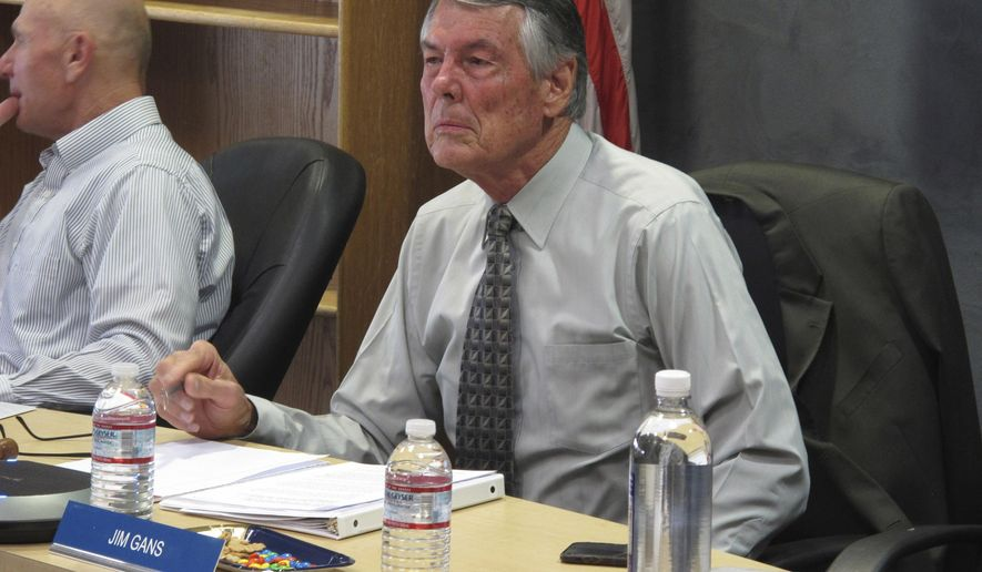 Nevada Environmental Commission Chairman Jim Gans listens to some of the eight hours of testimony at an appeal hearing Wednesday, Sept. 4, 2019, in Carson City, Nev., before his 3-member panel voted to uphold a water control pollution permit for a huge open pit molybdenum mine about 250 miles east of Reno. The Great Basin Mine Watch wanted the panel to rescind the permit for the mine it says could pollute Nevada's ground water for centuries. (AP Photo/Scott Sonner)