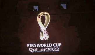 The landmark Kasbah of Oudayas is illuminated by the emblem of Qatar World Cup 2022, in Rabat, Morocco, Tuesday, Sept. 3, 2019. (AP Photo/Mosa'ab Elshamy)