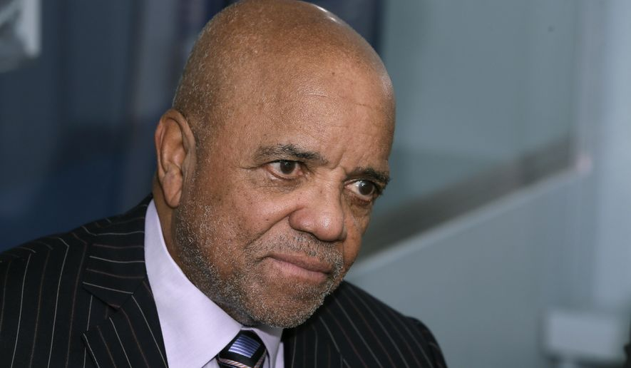 """FILE- In an Oct. 21, 2014 file photo, Motown Records founder Berry Gordy Jr., is interviewed at the Motown Museum in Detroit. Gordy Jr. is giving $4 million toward a project to expand a museum housed in the Detroit building where he built his music empire. Motown Museum announced Wednesday, Sept. 4, 2019, that Gordy's gift is the largest individual donation to the project. It coincides with Motown's 60th anniversary. Gordy says in a statement that he's """"excited about the future"""" of the museum and """"happy to support it."""" (AP Photo/Carlos Osorio, File)"""