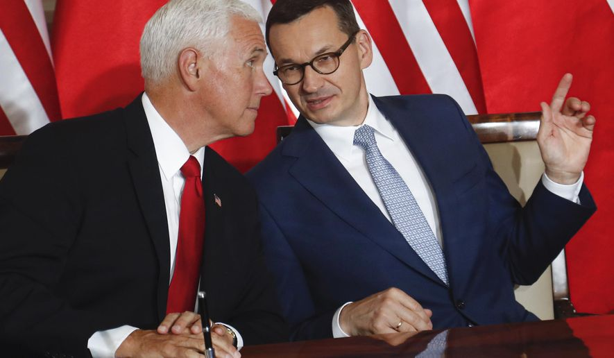 U.S. Vice President Mike Pence and Polish Prime Minister Mateusz Morawiecki, right, speak before signing an agreement in Warsaw, Poland, Monday, Sept. 2, 2019. The U.S. and Poland signed an agreement on Monday to cooperate on new 5G technology amid growing concerns about Chinese telecommunications giant Huawei. (AP Photo/Petr David Josek)