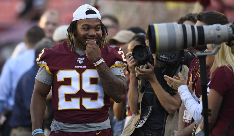 Washington Redskins running back Derrius Guice (29) jokes around with photographers before an NFL preseason football game against the Baltimore Ravens in Landover, Md., Thursday, Aug. 29, 2019. (AP Photo/Susan Walsh) **FILE**