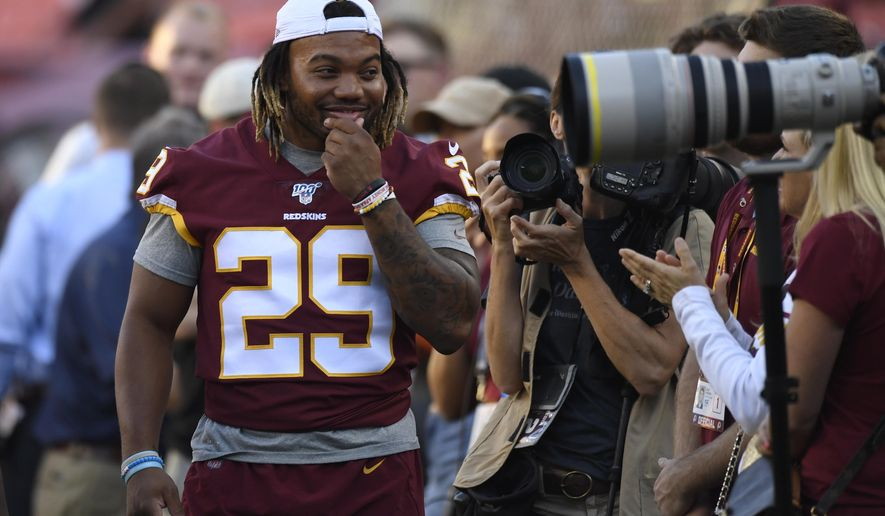 Washington Redskins running back Derrius Guice (29) jokes around with photographers before an NFL preseason football game against the Baltimore Ravens in Landover, Md., Thursday, Aug. 29, 2019. (AP Photo/Susan Walsh)