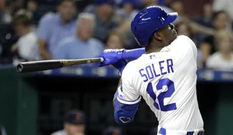 Kansas City Royals' Jorge Soler watches his solo home run during the fifth inning of the team's baseball game against the Detroit Tigers on Wednesday, Sept. 4, 2019, in Kansas City, Mo. It was the 40th home run of the season for Soler. (AP Photo/Charlie Riedel)