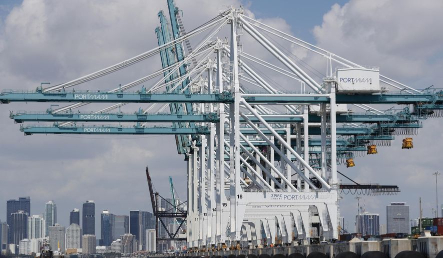 In this July 24, 2019 photo, large cranes to unload container ships are shown at PortMiami in Miami. On Wednesday, Sept. 4, the Commerce Department reports on the U.S. trade gap for July. (AP Photo/Wilfredo Lee)