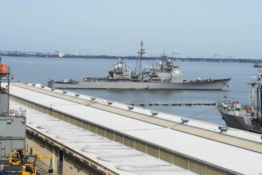 This image provided by the U.S. Navy shows the USS San Jacinto (CG-56) as it heads out of the berth at Naval Station Norfolk ahead of Hurricane Dorian in Norfolk, Va., Wednesday Sept. 4, 2019. (Alton Dunham/US Navy via AP) **FILE**