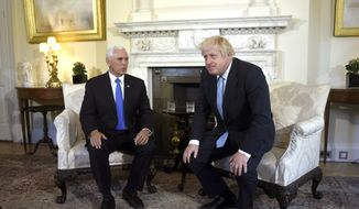 Britain's Prime Minister Boris Johnson, right, meets with U.S. Vice President Mike Pence inside 10 Downing Street in London, Thursday, Sept. 5, 2019. (Peter Summers/Pool photos via AP)