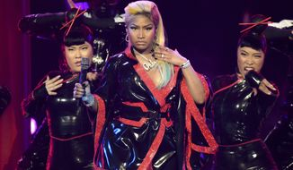 FILE - This June 24, 2018 file photo shows Nicki Minaj performing at the BET Awards in Los Angeles. The chart-topping rapper announced Thursday, Sept. 5, 2019, on Twitter that she decided to retire & have my family.  In the tweet, Minaj she took a jab at her critics and asked her fans to keep reppin me, do it til da death of me. In July, Minaj announced she was pulling out a show in Saudi Arabia to show support women's rights, gay rights and freedom of expression. She also canceled her appearance at the BET Experience Concert earlier this year. (Photo by Richard Shotwell/Invision/AP, File)