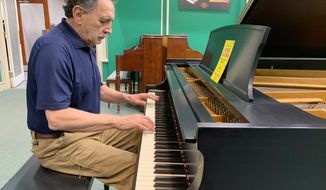 Nick Marjaritas, proprietor of Piano Man Superstore, plays a Steinway grand piano in his store on Thursday. The store, located on the 9500 block of Baltimore Avenue in College Park, is downsizing and relocating. (Sophie Kaplan/The Washington Times)