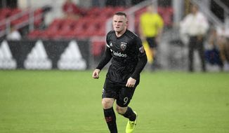 D.C. United forward Wayne Rooney runs on the field against Puebla during the second half of an international friendly soccer match, Wednesday, Sept. 4, 2019, in Washington. The game ended in a 1-1 tie. (AP Photo/Nick Wass) **FILE**