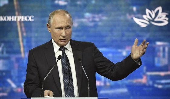 Russian President Vladimir Putin opens a plenary session of the Eastern Economic Forum in Vladivostok, Russia, Thursday, Sept. 5, 2019. Vladivostok hosts the Eastern Economic Forum on Sept. 4-6. (Alexander Nemenov/Pool Photo via AP)