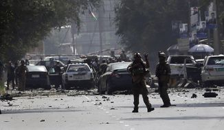 Afghan security personnel arrive at the site of car bomb explosion in Kabul, Afghanistan, Thursday, Sept. 5, 2019. A large car bomb rocked the Afghan capital on Thursday and smoke rose from a part of eastern Kabul near a neighborhood housing the U.S. Embassy, the NATO Resolute Support mission and other diplomatic missions. At least three people were killed and another 30 wounded, a hospital director said. (AP Photo/Rahmat Gul)