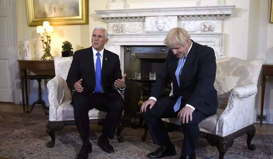 Britain's Prime Minister Boris Johnson, right, meets with US Vice President Mike Pence inside 10 Downing Street in London, Thursday, Sept. 5, 2019. (Peter Summers/Pool photos via AP)