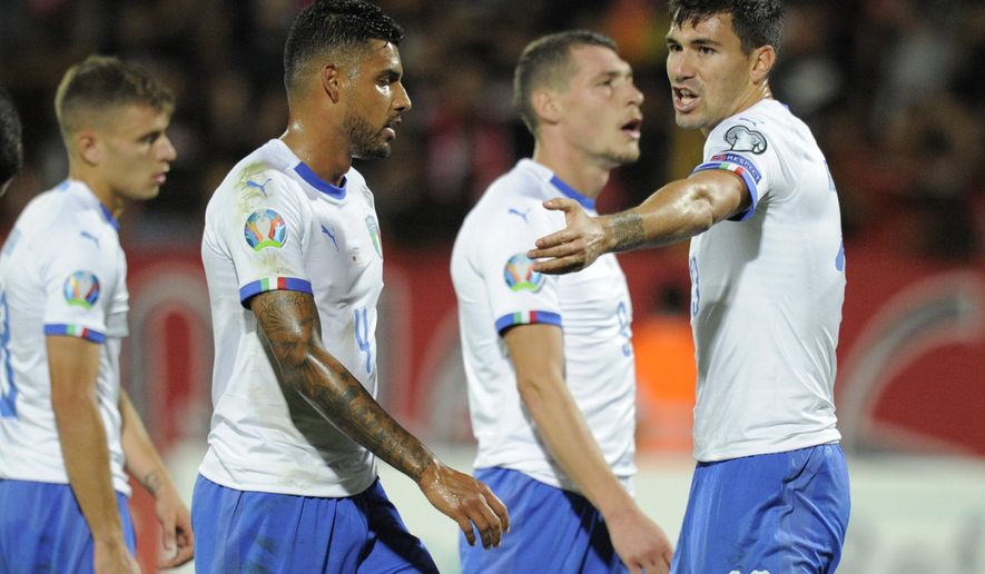 Italy's Alessio Romagnoli, right, reacts during the Euro 2020 group J qualifying soccer match between Armenia and Italy at the Vazgen Sargsyan Republican stadium in Yerevan, Armenia, Thursday, Sept. 5, 2019. (AP Photo/Hakob Berberyan)