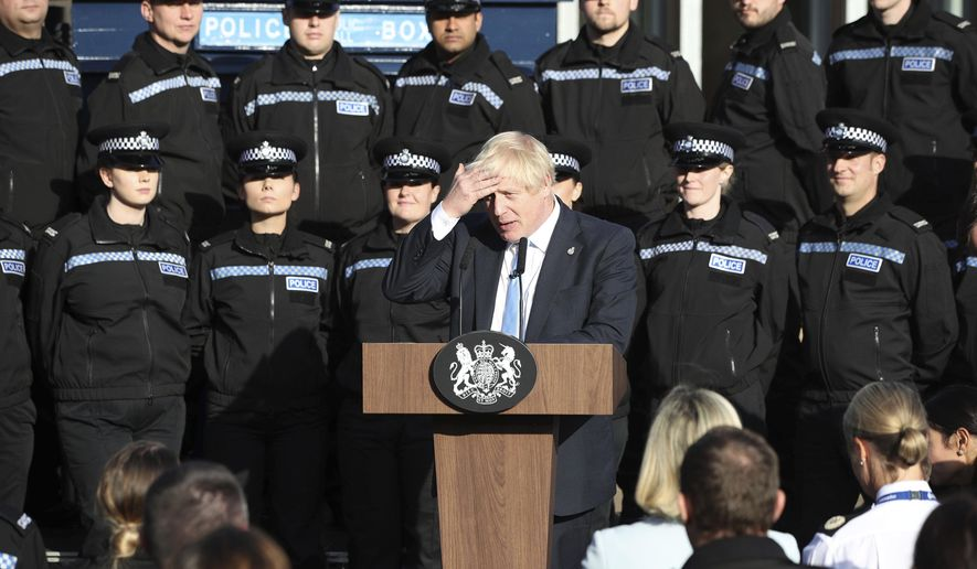 Britain's Prime Minister Boris Johnson makes a speech to police during a visit to West Yorkshire in England, Thursday, Sept. 5, 2019. Prime Minister Boris Johnson kept up his push Thursday for an early general election as a way to break Britain's Brexit impasse, as lawmakers moved to stop the U.K. leaving the European Union next month without a divorce deal. (Danny Lawson/PA via AP)