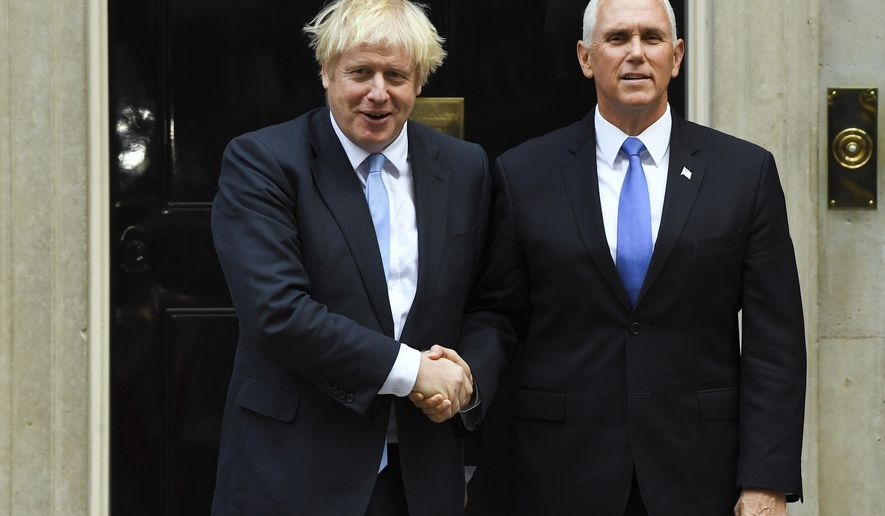 Britain's Prime Minister Boris Johnson, left, greets US Vice President Mike Pence on the doorstep of 10 Downing Street, in London, Thursday, Sept. 5, 2019.(AP Photo/Alberto Pezzali)