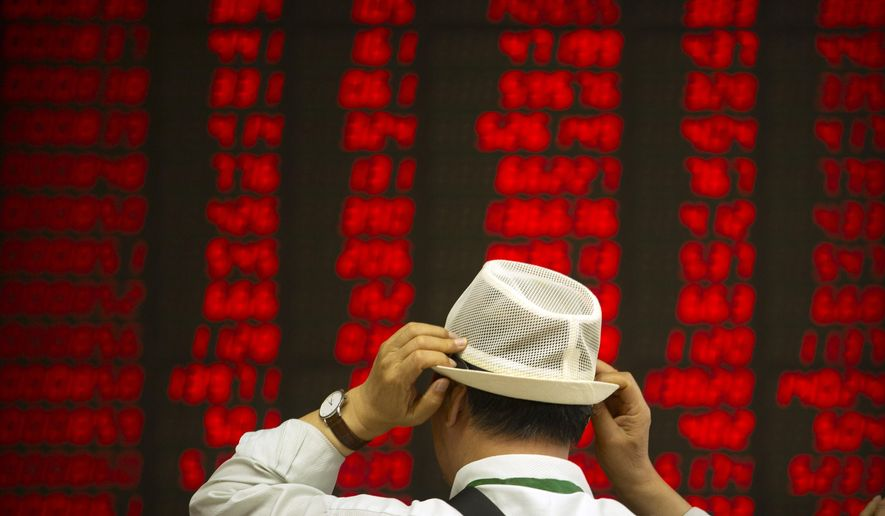 A Chinese investor adjusts his hat as he monitors stock prices at a brokerage house in Beijing, Thursday, Sept. 5, 2019. Asian shares were mostly higher Thursday amid encouraging global developments, including British lawmakers seeking a less chaotic exit from the European Union and easing political tensions in Hong Kong. (AP Photo/Mark Schiefelbein)