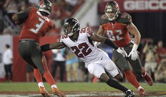 FILE - In this Dec. 18, 2017, file photo, Atlanta Falcons strong safety Keanu Neal (22) pressures Tampa Bay Buccaneers quarterback Jameis Winston (3) during the second half of an NFL football game in Tampa, Fla. The Falcons won 24-21. Neal is one of several key defensive players back from injury for the Falcons after a disappointing season in 2018. (AP Photo/Phelan M. Ebenhack, File)