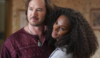 "This image released by ABC shows Mark-Paul Gosselaar, left, and Tika Sumpter in a scene from ""mixed-ish,"" premiering on Sept. 24 on ABC. (Eric McCandless/ABC via AP)"