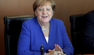 German Chancellor Angela Merkel smiles as she arrives for the weekly cabinet meeting at the Chancellery in Berlin, Germany, Wednesday, Sept. 4, 2019. (AP Photo/Michael Sohn)