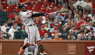 San Francisco Giants' Kevin Pillar follows through on a two-run home run during the eighth inning of the team's baseball game against the St. Louis Cardinals on Wednesday, Sept. 4, 2019, in St. Louis. (AP Photo/Jeff Roberson)