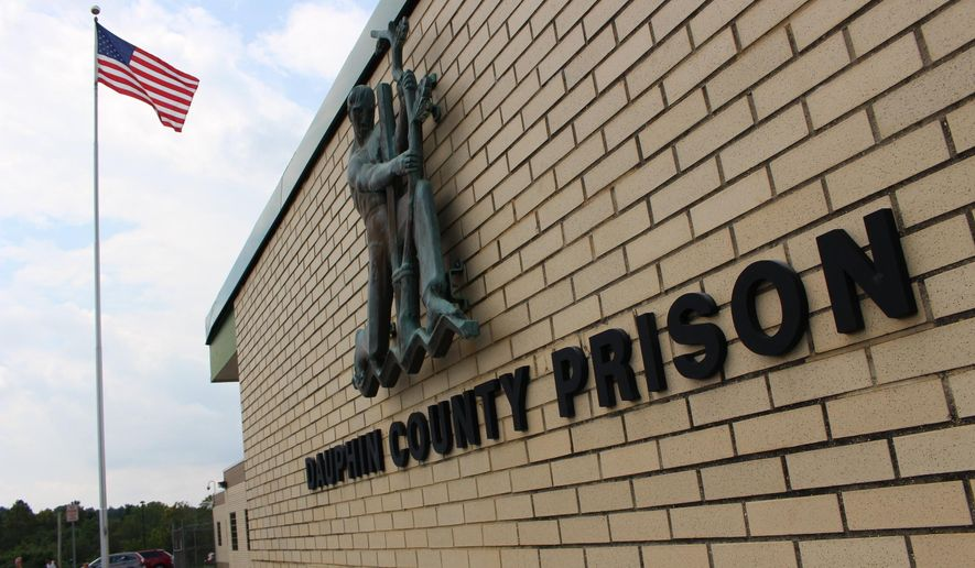 FILE - This Aug. 15, 2019 photo, shows the Dauphin County Prison in Harrisburg, Pa. Relatives of Ty'rique Riley, a 21-year-old inmate at the prison who died under mysterious circumstances, says they still have questions after a coroner ruled he died of natural causes.  Dauphin County Coroner Graham Hetrick said Thursday, Sept. 5, 2019,  that Riley had swelling in his brain and blood vessels and clots in his lungs. (AP Photo/Michael Rubinkam, File)