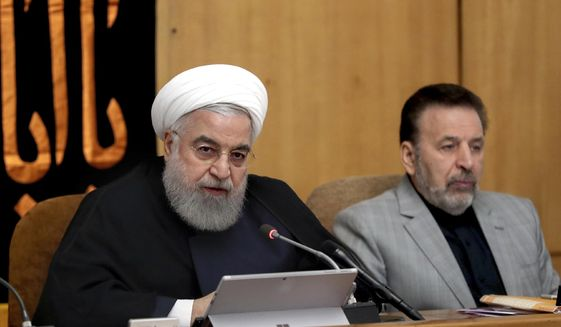 In this photo released by the office of the Iranian Presidency, President Hassan Rouhani speaks in a Cabinet meeting in Tehran, Iran, Wednesday, Sept. 4, 2019. (Iranian Presidency Office via AP)