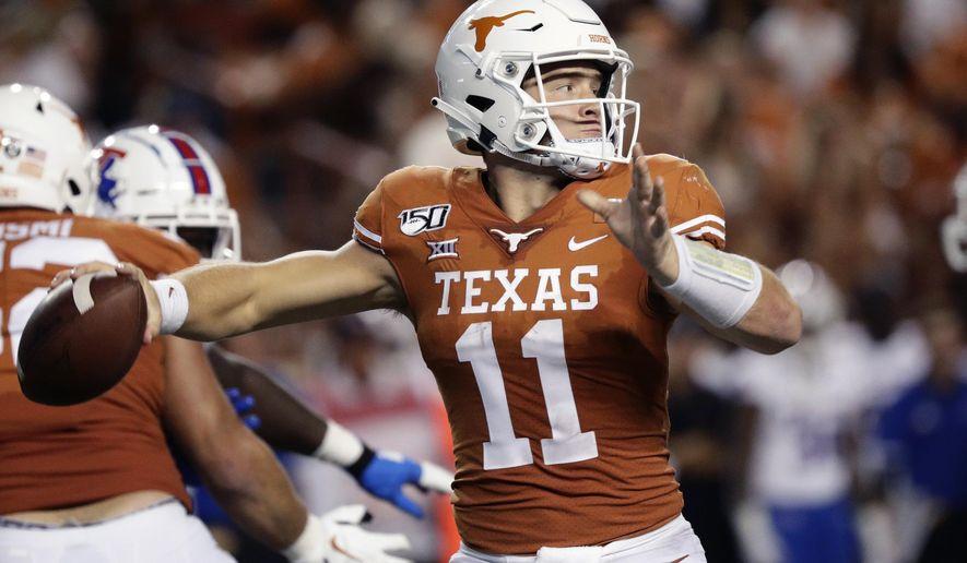 Texas quarterback Sam Ehlinger (11) throws against Louisiana Tech during the second half of an NCAA college football game, Saturday, Aug. 31, 2019, in Austin, Texas. (AP Photo/Eric Gay)