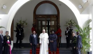 Pope Francis poses with Mozambique President Filipe Jacinto Nyusi, left, and his wife Isaura Nyusi at the Ponta Vermelha Palace on the occasion of their meeting, in Maputo, Mozambique, Thursday, Sept. 5, 2019. Francis is starting his first full day in Mozambique with a speech before government authorities and invited members of the armed opposition who just signed a permanent cease-fire to solidify the country's peace process. (AP Photo/Alessandra Tarantino)