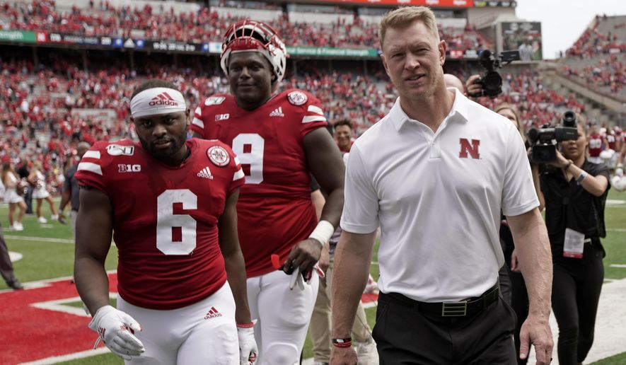 In this Aug. 31, 2019, photo, Nebraska safety Eric Lee Jr. (6) walks off the field next to head coach Scott Frost following an NCAA college football game against South Alabama, in Lincoln, Neb. Lee finally had his breakout game for Nebraska last week. The fifth-year senior safety saw his role increase against South Alabama when Deontai Williams went out with an injury. Lee ran back an interception for a touchdown and picked off another pass. This week he returns to his home state to play against Colorado. (AP Photo/Nati Harnik)