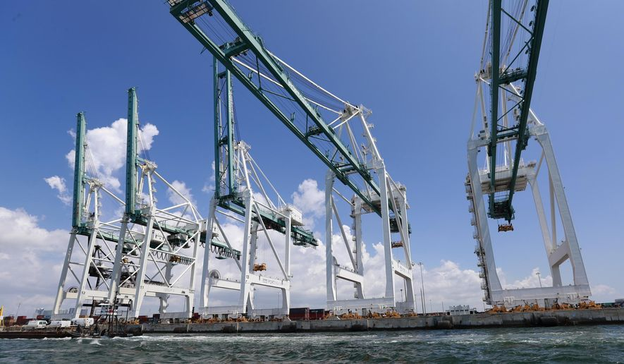 In this July 24, 2019 photo, large cranes to unload container ships are shown at PortMiami in Miami. On Thursday, Sept. 5, the Labor Department issues revised data on productivity in the second quarter. (AP Photo/Wilfredo Lee)