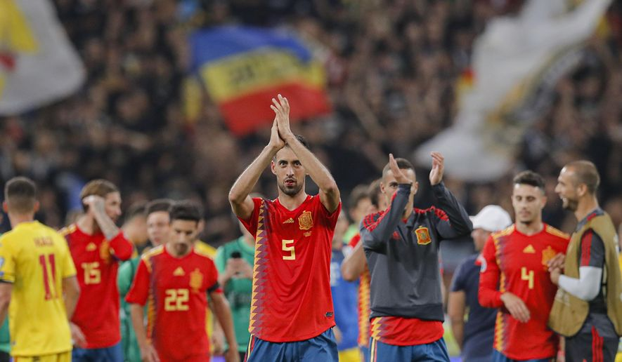 Spain's Sergio Busquets applauds spanish fans during the Euro 2020 group F qualifying soccer match between Romania and Spain, at the National Arena stadium in Bucharest, Romania, Thursday, Sept. 5, 2019. (AP Photo/Vadim Ghirda)