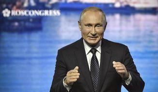 Russian President Vladimir Putin opens a plenary session of the Eastern Economic Forum in Vladivostok, Russia, Thursday, Sept. 5, 2019. Vladivostok hosted the Eastern Economic Forum on Sept 4-6. (Alexander Nemenov/Pool Photo via AP) ** FILE **