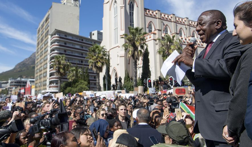South African President, Cyril Ramaphosa, right, addresses protesters against gender-based violence outside parliament in Cape Town, South Africa, Thursday, Sept. 5, 2019. The protesters are demanding the government crack down on gender-based violence, as several recent and brutal murders of young South African women have gripped the nation. (AP Photo)