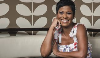 "This Aug. 8, 2019 photo shows former NBC ""Today"" show co-host, Tamron Hall, posing for a portrait at Ruby's Vintage Harlem in New York to promote her self-titled syndicated talk show, premiering Sept. 9. (Photo by Christopher Smith/Invision/AP)"