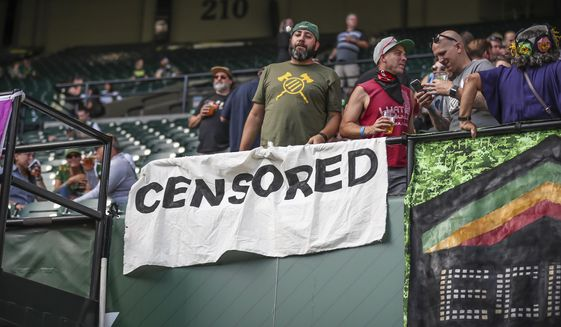 File - In this Aug. 23, 2019, file photo, Portland Timbers fans wait for the team's MLS soccer match against the Seattle Sounders in Portland, Ore. Several Timbers fans have been banned for three games for waving flags that display an antifascist symbol, in apparent violation of Major League Soccer's policy that prohibits political displays at games. (Serena Morones/The Oregonian via AP)