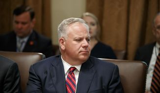 FILE - In this July 16, 2019 file photo interior Secretary David Bernhardt listens during a Cabinet meeting in the Cabinet Room of the White House in Washington. On Thursday, Sept. 5, 2019, 30 retired executives from the Bureau of Land Management, which Bernhardt oversees, wrote him a letter saying that moving the bureau headquarters to Grand Junction, Colorado, and dispersing managers across 11 Western states could lead to worse stewardship of public lands. The department announced the move in July, saying it would lead to better decisions and save money, but some retired federal employees dispute that. (AP Photo/Alex Brandon, File)