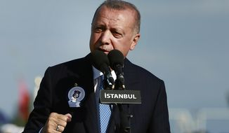 Turkey's President Recep Tayyip Erdogan delivers a speech to graduates of a military academy in Istanbul, Saturday, Aug. 31, 2019. Erdogan said the U.S. had up to three weeks to satisfy Turkish demands and has threatened to launch a unilateral offensive into northeastern Syria if plans to establish a so-called safe zone along Turkey's border fail to meet his expectations. Earlier this month, Turkish and U.S. officials agreed to set up the zone east of the Euphrates River. (Presidential Press Service via AP, Pool)