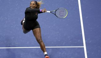 Serena Williams, of the United States, follows through on a return to Qiang Wang, of China, during the quarterfinals of the U.S. Open tennis tournament Tuesday, Sept. 3, 2019, in New York. (AP Photo/Seth Wenig)