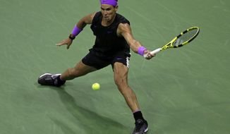 Rafael Nadal, of Spain, hits a return to Diego Schwartzman, of Argentina, during the quarterfinals of the U.S. Open tennis tournament Wednesday, Sept. 4, 2019, in New York. (AP Photo/Adam Hunger)
