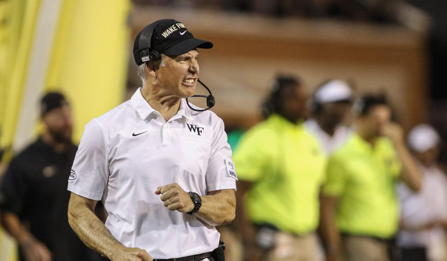 Wake Forest head coach Dave Clawson reacts on the sideline as his team plays against Utah State in the first half of an NCAA college football game in Winston-Salem, N.C., Friday, Aug. 30, 2019. (AP Photo/Nell Redmond)
