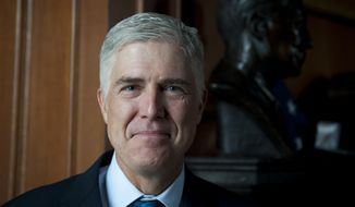 Supreme Court Justice Neil M. Gorsuch says he once fished with his predecessor, the late Justice Antonin Scalia. (Rod Lamkey Jr. for The Washington Times)