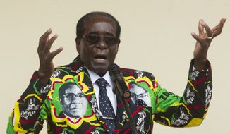 In this Saturday, Dec. 17, 2016, file photo, then-Zimbabwean President Robert Mugabe addresses people at an event before the closure of his party's 16th Annual Peoples Conference in Masvingo, south of the capital Harare. On Friday, Sept. 6, 2019, Zimbabwe President Emmerson Mnangagwa said his predecessor Mugabe, age 95, has died. (AP Photo/Tsvangirayi Mukwazhi, File)